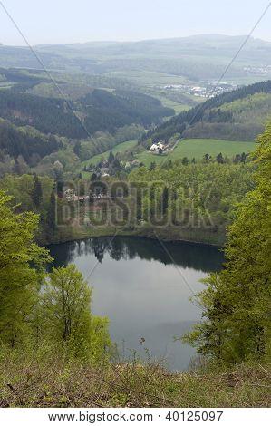 idyllic scenery showing a maar in the Vulkan Eifel wich is a region in the Eifel Mountains in Germany poster