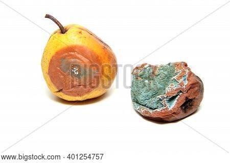 Two Rotten And Uneatable Pears. Isolated On A White Background.
