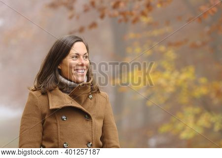 Happy Adult Lady Contemplating Views Walking In A Park In Fall Season