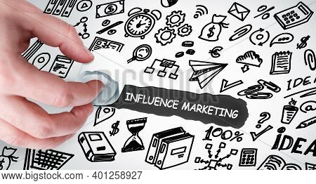 Technology, Internet And Network Concept. Young Businessman Shows The Word: Influence Marketing