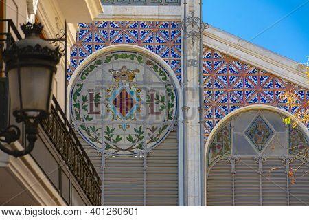 Valencia, Spain. October 11, 2020: Tiled Walls Of The Main Facade Of The Central Market. Blazon Of V
