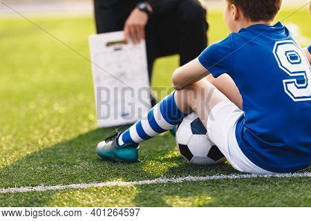 Coach Trainer Teaching Kids On Football Field. Football Coach Coaching Children. Soccer Football Tra