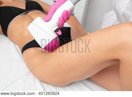 Elos Epilation Hair Removal Procedure On A Woman's Body. Beautician Doing Laser Rejuvenation In A Be
