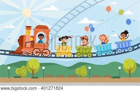 Young Children Enjoying A Fairground Ride In The Colorful Carriages Of An Elevated Train With Engine