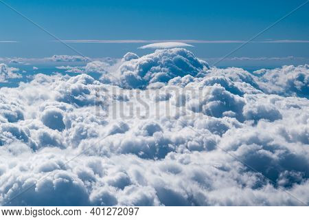 Blue Sky Full Of White Clouds In A Photo Taken In An Airplane