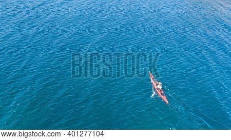 Aerial Drone Photo Of Red Sport Canoes As Shot From Above In Turquoise Clear Sea
