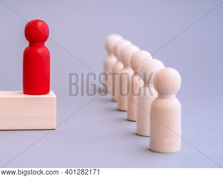 Wooden Figures Of People. Career And Personal Growth, Business Motivation. Leadership Concept. Diffe