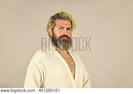 Man Wear Bathrobe At The Bathroom. Handsome Man In The Morning. Bearded Guy In White Terry Bathrobe