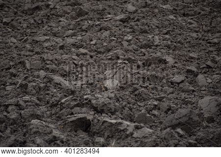 Detail Of Plowed Land Texture In A Field During Winter Period