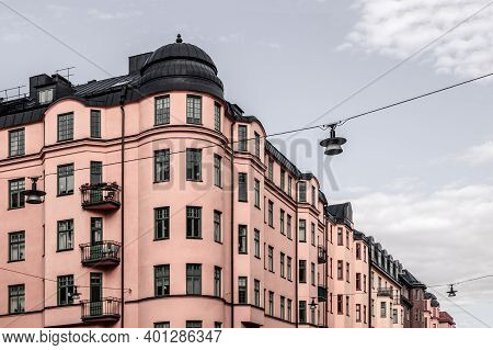 Beautiful Pink Building On Cloudy Sky Background. Stockholm, Sweden.
