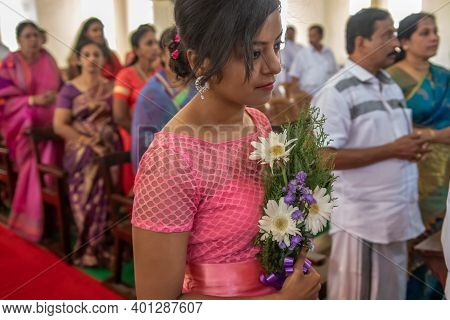 Kerala, India, 08-12-2017. Maid Of Honor. Catholic Wedding In The Province Of Kerala In South India.