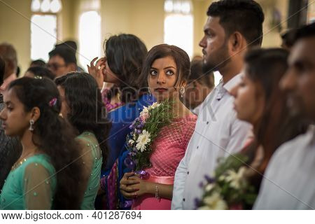 Kerala, India, 08-12-2017. Maid Of Honor At Church. Catholic Wedding In The Province Of Kerala In So