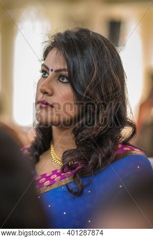 Kerala, India, 08-12-2017. Bridesmaid At Ceremony. Catholic Wedding In The Province Of Kerala In Sou