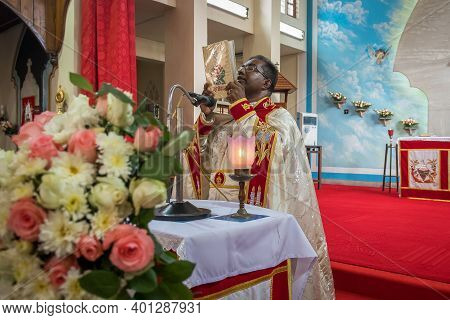 Kerala, India, 08-12-2017. Priest During Ceremony. Catholic Wedding In The Province Of Kerala In Sou