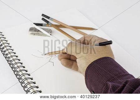 Man Drawing On Paper