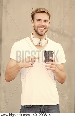 Try This. Happy Man Pointing At Hot Cup Outdoors. Pointing Gesture To Takeaway Drink. Index Finger P
