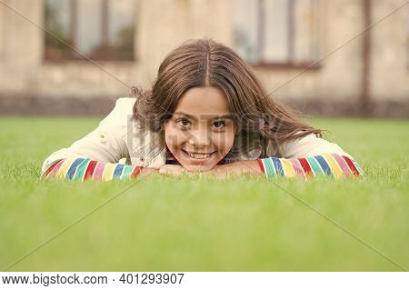 Look At Her Now. School Break For Rest. Adorable Pupil. Girl Kid Laying Lawn. Girl School Uniform En