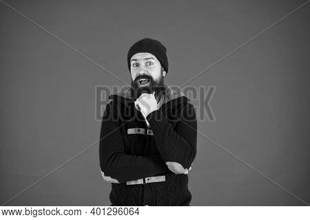 Think And Decide. Winter Menswear. Man Bearded Warm Jumper And Hat Red Background. Winter Season Men