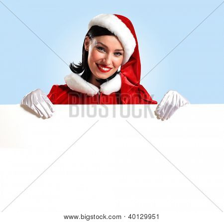 Portrait of a santa girl with a blank banner