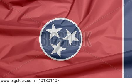 Fabric Flag Of Tennessee. Crease Of Tennessee Flag Background, A Blue Circle With Three White Stars