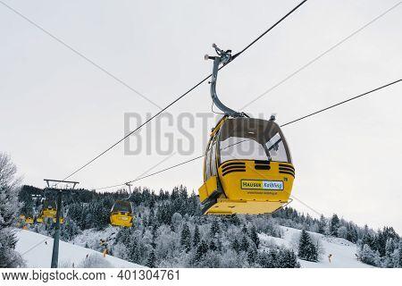Haus Im Ennstal, Austria - December 29 2020: Hauser Kaibling Yellow Lift 8 Seater Gondola With Logo