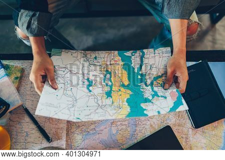 Tourist Hold Map And Planning And Reservation. Travel, Holiday, Vocation Concept.