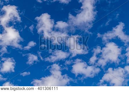 A Few Small Clouds In A Clear Blue Sky, Summer Bright Image Of The Sky.