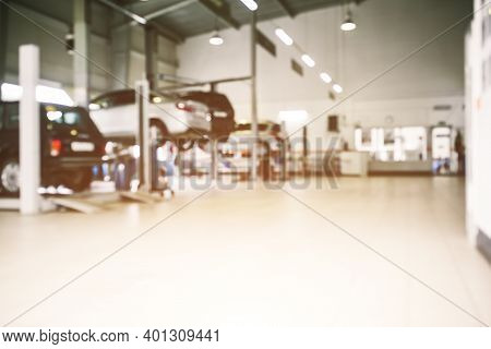 Car Repair Service In Defocus, Industrial Background. Cars On Lifts, Transport Service Area. Copy Sp