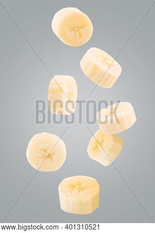 Falling Sliced Fresh Banana Isolated On White