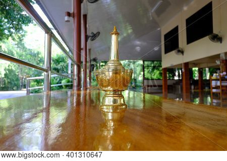 Buddhism Vintage Styled Water Container For Pouring Water As A Sign Of Dedication Of Merit To The De