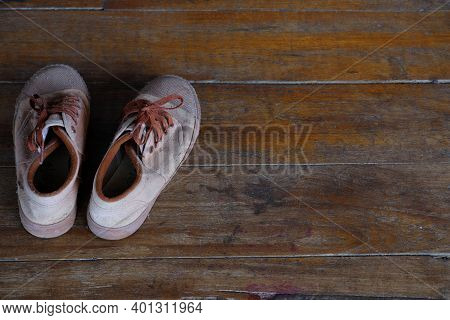 Student Old Brown Standard Shoes Or Sneakers On The Wooden Floor Of School Ancient Building On Semes