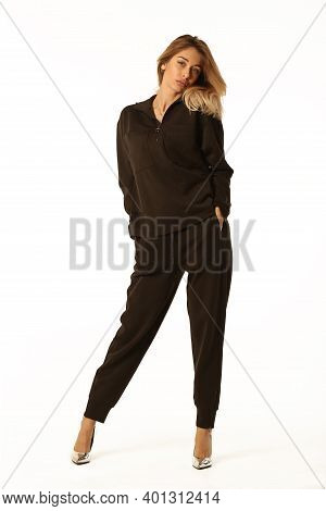 Blond Woman In Black Pantsuit Full Body Portrait Isolated On White