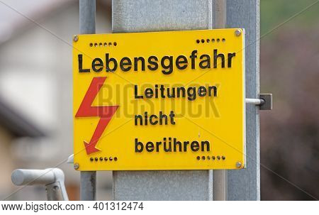 German Warning Sign `don't Touch High Voltage Power Lines, Danger To Life` German: `hochspannung, Le