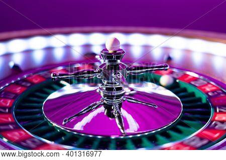 Roulette wheel close up -  Ladies Pink Casino - Selective Focus