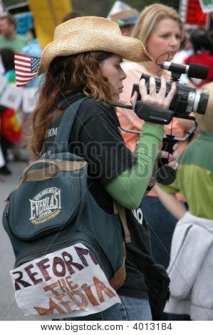 Woman Filming Iraq War Protest