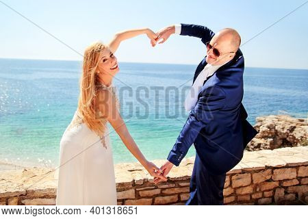 Wedding. Wedding Married Couple Of Hands Make A Real Heart. Happy Couple Day Wedding. Beautiful Brid