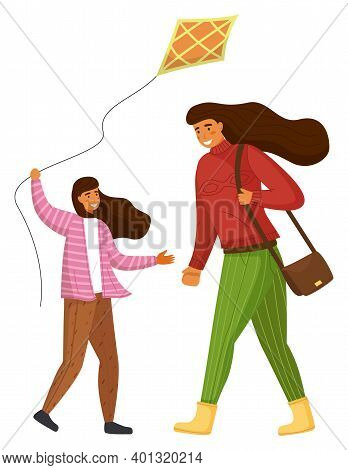Cheerful Girl In Striped Sweater, Brown Pants Plays With Kite, Long-haired Mother In Red Sweater And