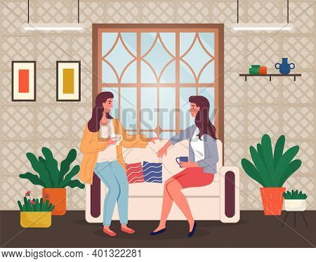 Brunette Women Sitting At Sofa And Talking. Friends Relaxing At Home With A Cup Of Tea Or Coffee. Ha
