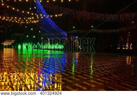 Street Christmas Decoration In The Night . Rainy New Year Nighttime