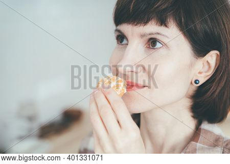 Anosmia, Restore Sense Of Smell. Covid-19 Causes Loss Of Smell. Close Up Happy Woman Sniffing Citrus