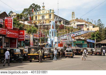 Munnar, India - February 14, 2011: Mount Carmel Church And Rickshaws On The Main Road