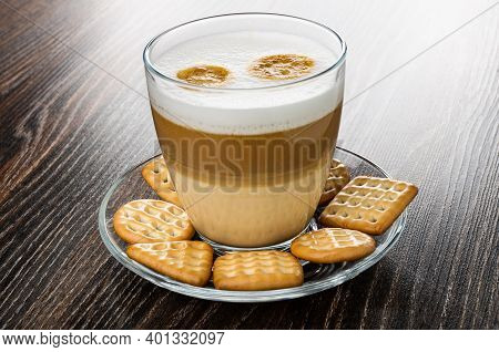 Different Cookies, Transparent Glass With Latte-macchiato In Saucer On Dark Wooden Table