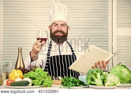 Exquisite Dinner Concept. Wine Degustation. Match Wine And Food Like Expert. Man Wear Hat And Apron