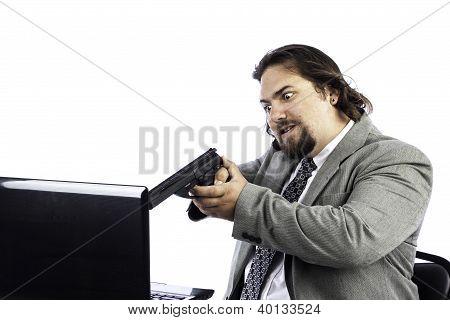 Man Holding Gun On Laptop