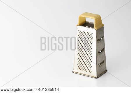 Kitchen Utensils. Old And Rusty Used Grater Made Of Stainless Steel Isolated Over Pure White Backgro