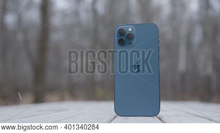 Moscow, Russia-november, 2020: Back Of New Iphone. Action. New Stylish Iphone Stands On Background O