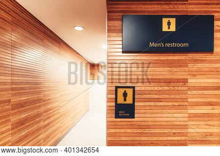 A Bright Interior With A Wood Cladding Of A Modern Entrance To A Public Men Toilet In An Airport Ter