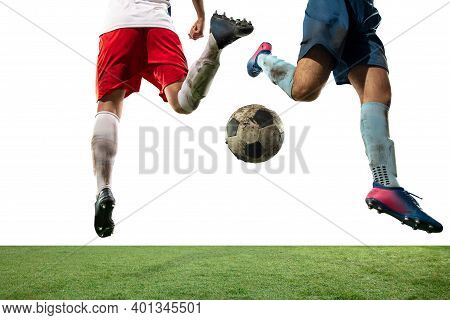 Tensioned. Close Up Legs Of Professional Soccer, Football Players Fighting For Ball On Field Isolate