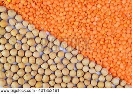 Lentils And Chickpeas. The Whole Frame Is Divided Obliquely In Half, Half Covered With Lentils And H
