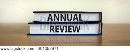 Annual Review Symbol. Concept Words 'annual Review' On Books On A Beautiful Wooden Table, White Back
